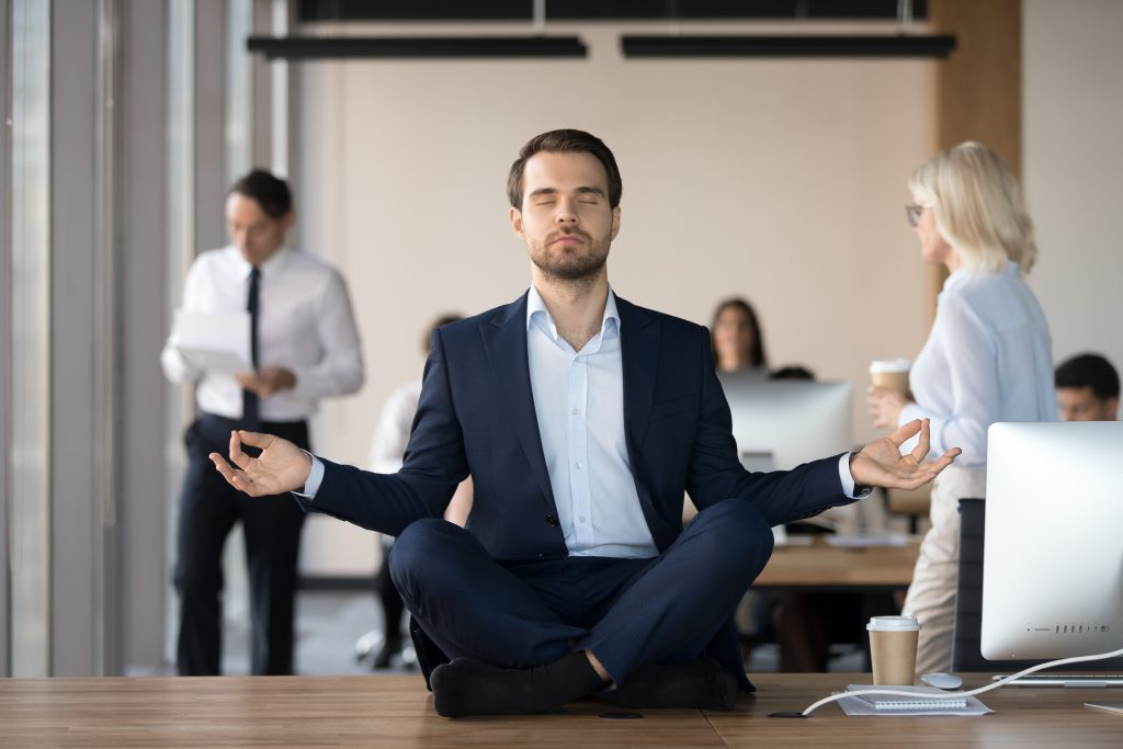 Mindful,Calm,Businessman,In,Suit,Meditating,At,Office,Sitting,In